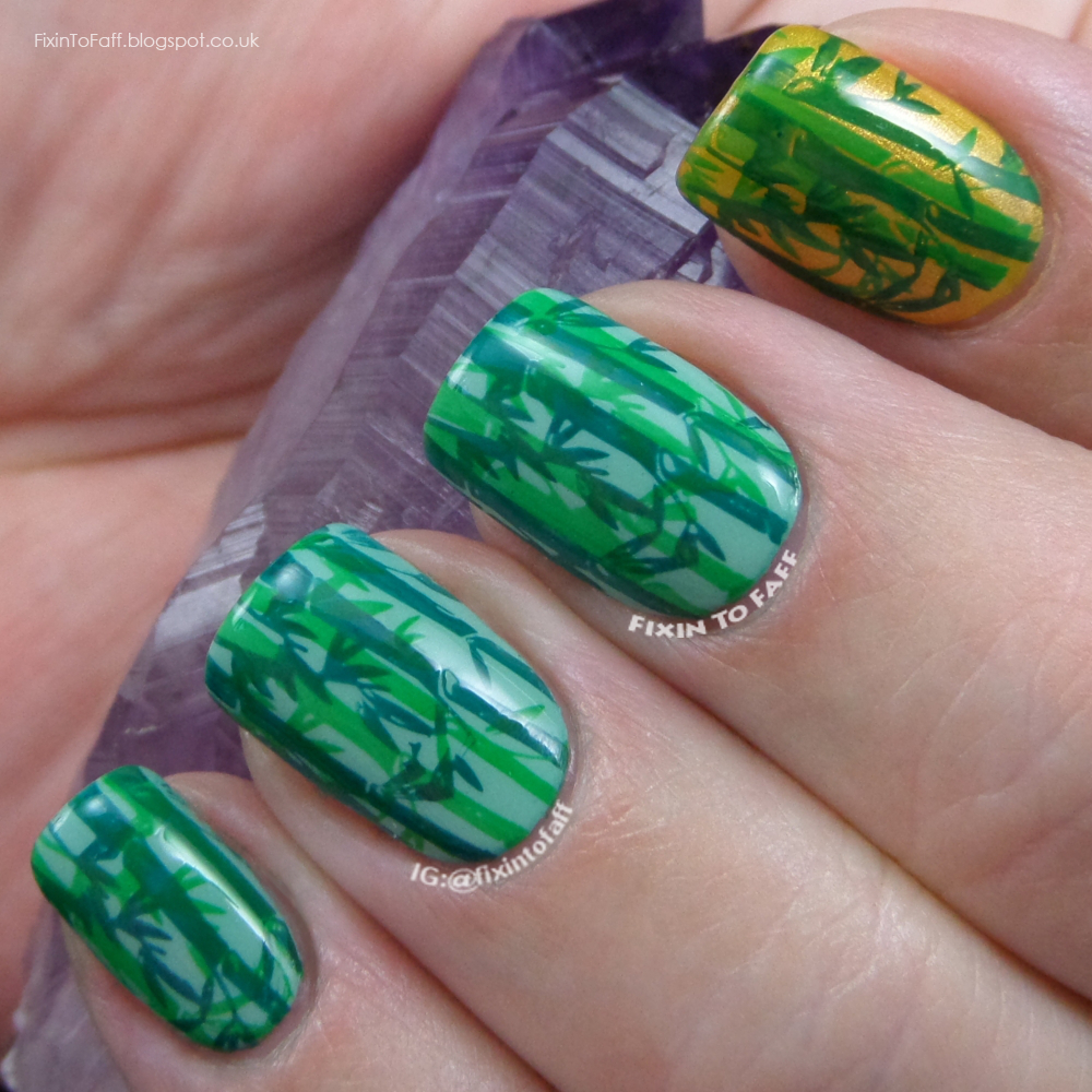 Double-stamped green bamboo forest nail art.