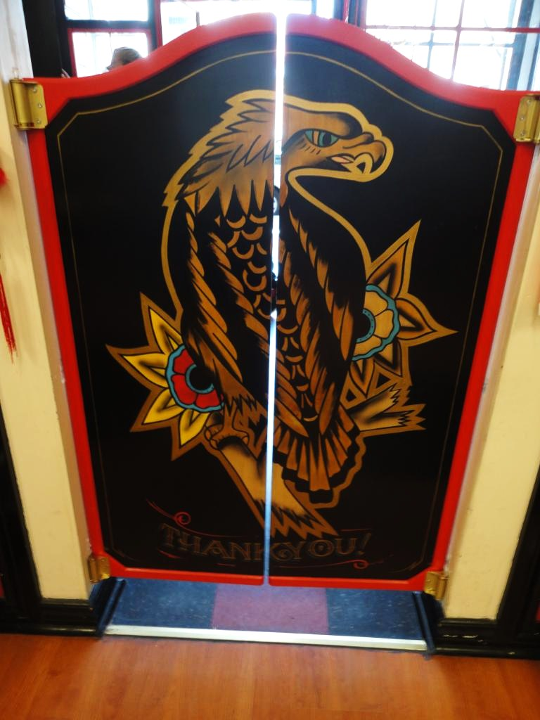 Dobell signs government st tattoo saloon doors for Street sign tattoos
