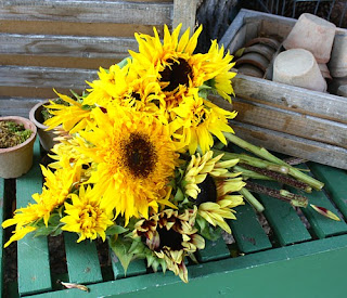 bouquet of sunflowers on a green wooden table