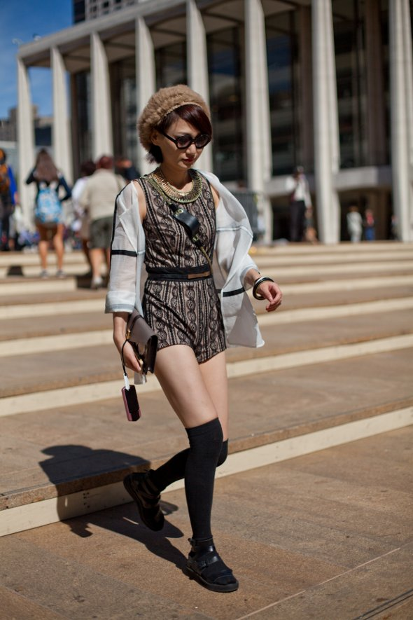 one piece patterned short tank top jumper, thigh high socks with sandles, fur hat things, clutch and cell phone, new york fashion week street style, asians street style, womens street style in new york, fashion bloggers, street style bloggers