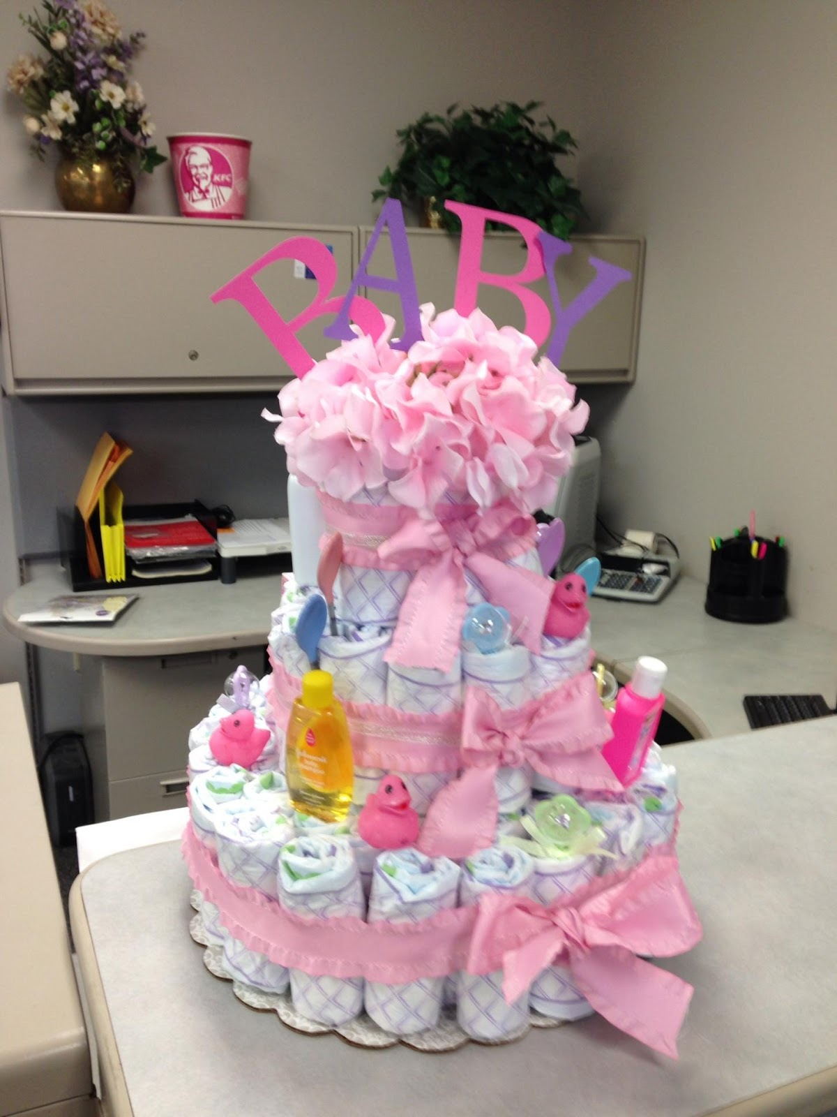 The beauty of etcetera diy baby diaper cake at craft stores they sell kits to do these but honestly it was super simple to do this by yourself and the kits are expensive so it saves your money solutioingenieria Images