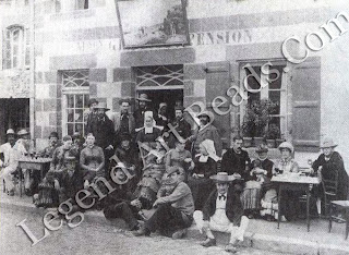 Gauguin sitting on the kerb, third from the right poses with fellow artists outside the Pension Gloanec, the favorite hotel for painters.