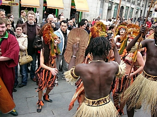 Europeans enjoying a taste of the african culture join in the dance