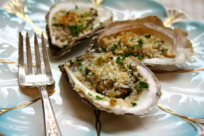 Flash broiled oysters on the half shell with garlic and herbs