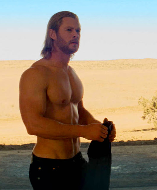 a shirtless Chris Hemsworth as Thor