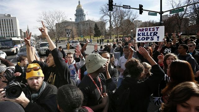 Denver student protesters cheered when car struck officer