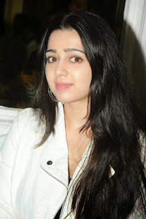 Actress Charmi Kaur Pictures in Jeans at One by Two Movie Celetes 20 Years Event 0039