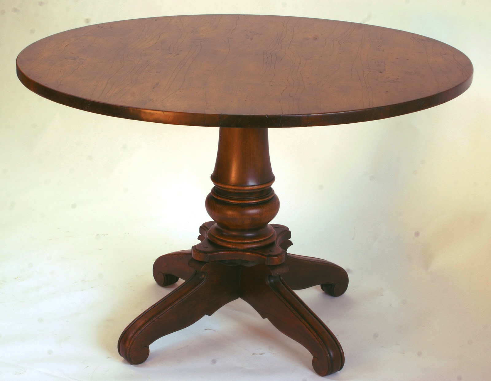 round French provincial breakfast nook table with antiqued finish in a medium walnut tone