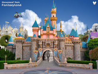 Screenshot showing a figure of Walt Disney in front of the Disneyland Castle