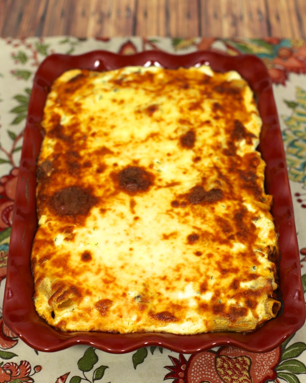 Cheesy Baked Rigatoni Recipe - rigatoni, Italian sausage, spaghetti sauce, cream cheese, sour cream, cottage cheese/ricotta, mozzarella and parmesan cheese. Ooey, gooey, cheesy heaven! Can make ahead and refrigerate or freeze. Makes a ton. Great for a potluck!