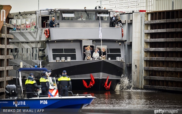 Dutch Queen Maxima, and Infrastructure and Environment Minister Melanie Schultz van Haegen ride a boat during the opening of the Maxima Channel in Rosmalen