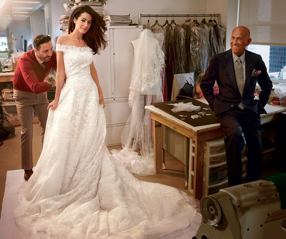 http://www.eonline.com/news/584025/see-amal-alamuddin-s-wedding-dress-fitting-plus-check-out-her-reception-dress