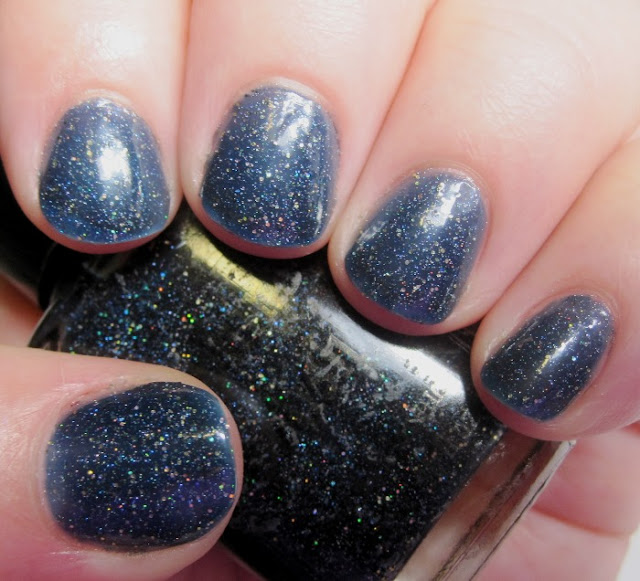 Night Stroll, a dark blue polish with holo glitters