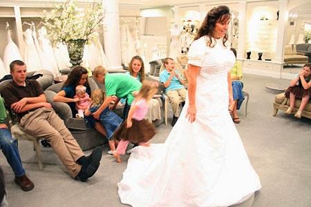 Michelle Duggar vow renewal Kleinfeld bridal