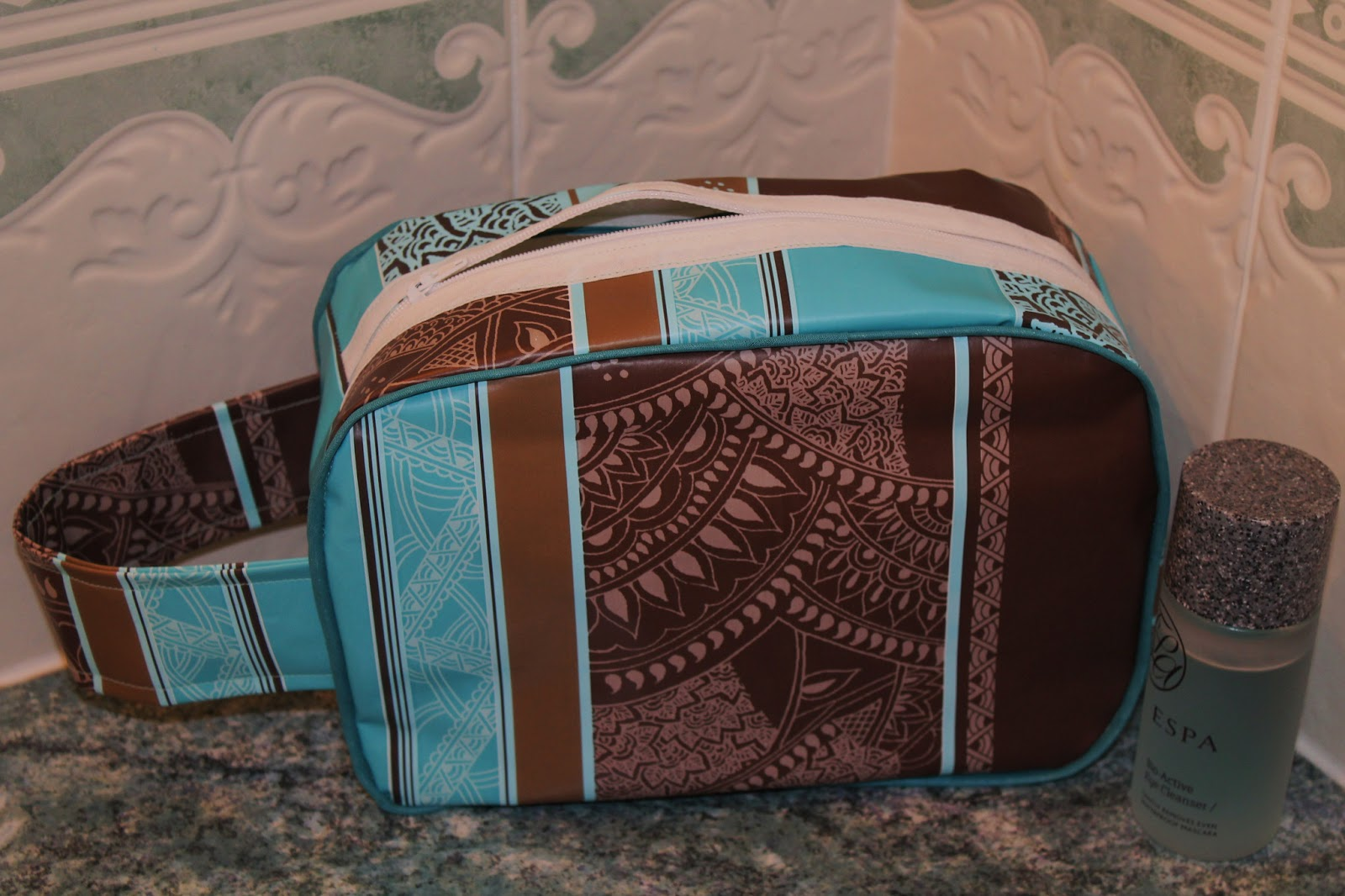 Brown and turquoise patterned oil cloth wash bag