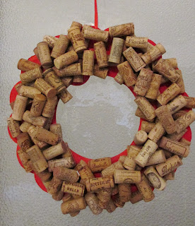 14 in diameter red painted cardboard wreath covered in 45 wine corks