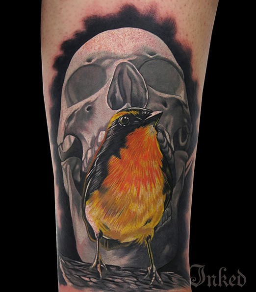 Grey skull with yellow bird tattoo