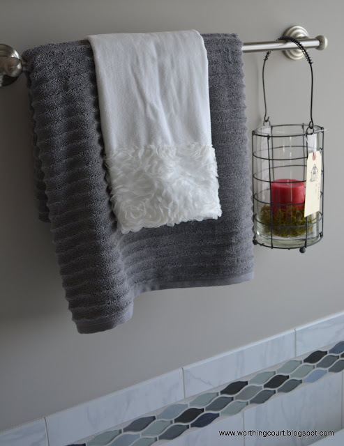 candle and lacy towel hanging from a towel bar via Worthing Court blog