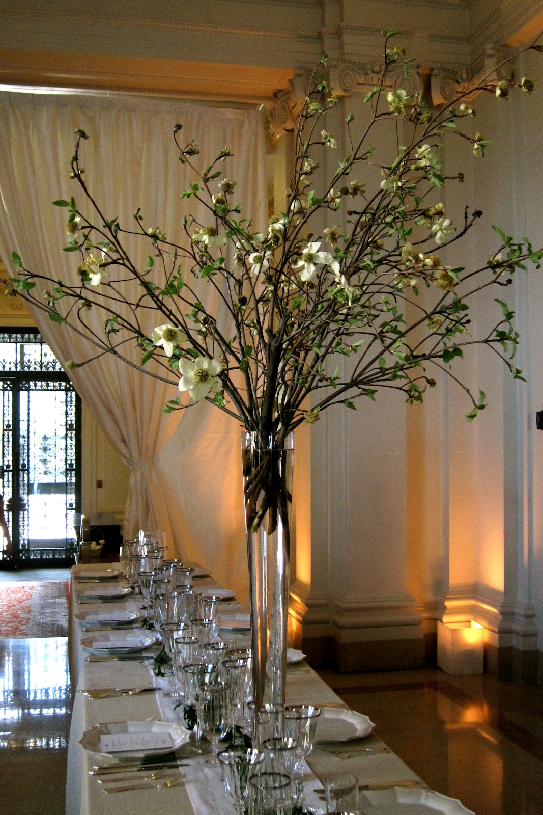 Michael daigian design memorial day weekend madness we created five tall centerpieces in glass pilsner vases filled with white blossomed dog wood lush green ivy and jasmine it gave a dramatic and elegant reviewsmspy