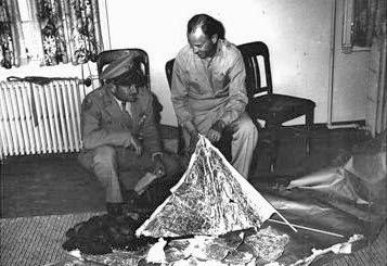 Major Jesse A. Marcel and Captain Sheridan Cavitt investigating the debris