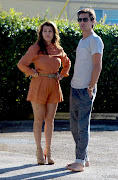 Kourtney Kardashian wearing Long Sleeved Orange Romper