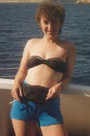 on a boat in a bikini