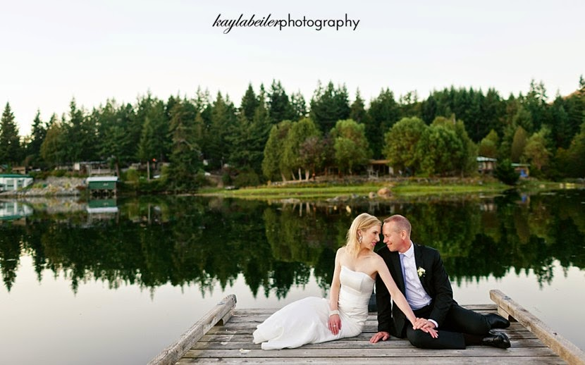 bride and groom on the dock photo
