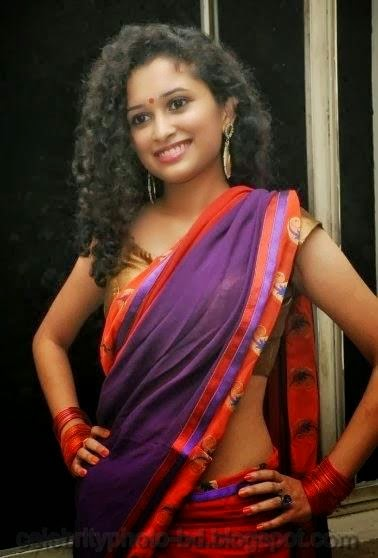 latest+Photo shoot+of+Manochitra+with+a+Hot+Pink+Sari004