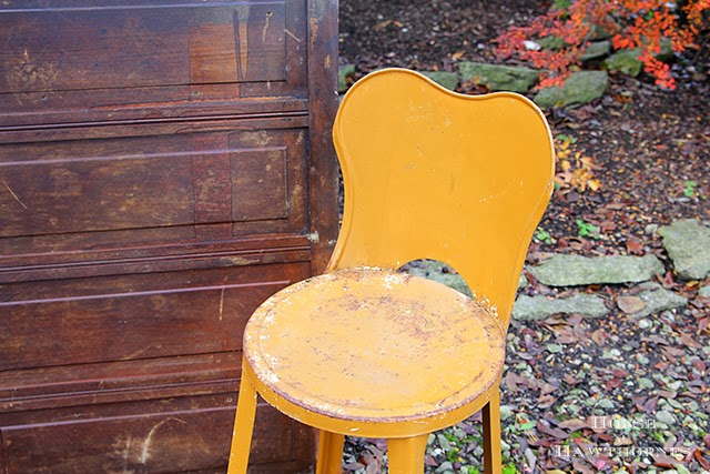 Vintage metal child's chair from a fall barn sale