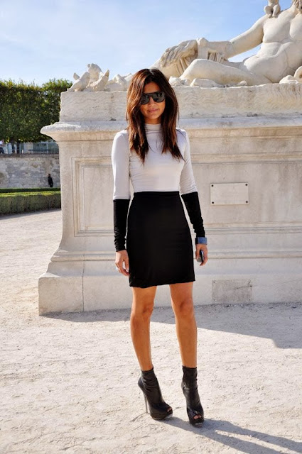Long Sleeveless White Shirt With Black Skirt And Black Heel Shoes