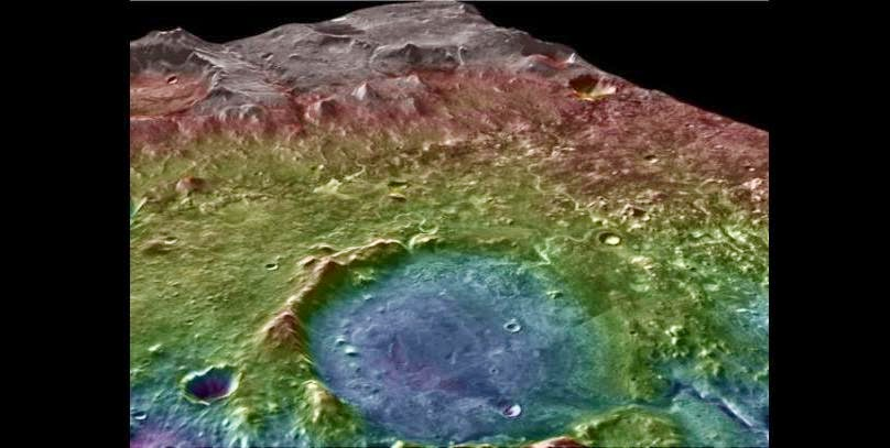 A false-color topographic map (blue marks low elevations) shows the area around Jezero Crater. Flowing water would have gathered any biologic or organic material from a wide area and deposited it at the crater, making it a logical landing site for a future Mars rover mission. Credit: NASA/MSSS/ASU/GSFC