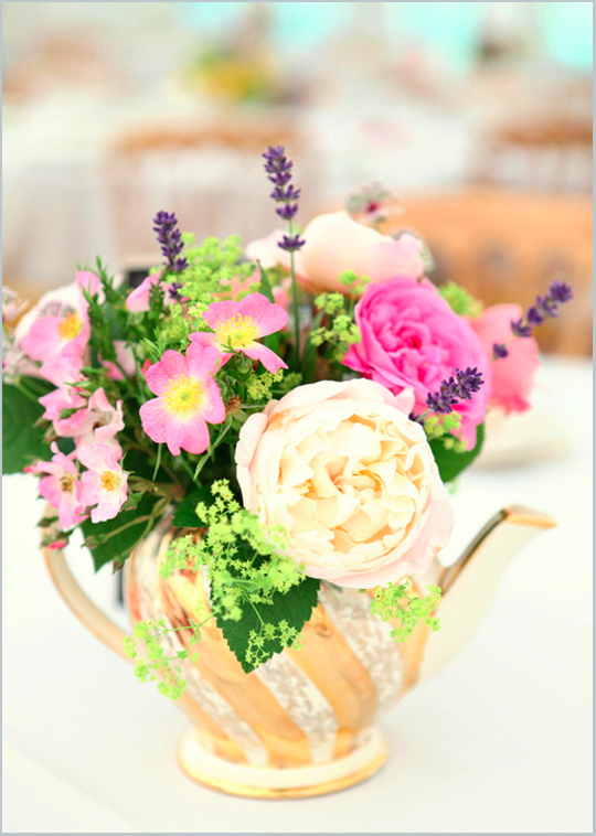 flowers in a gold and white vintage teapot