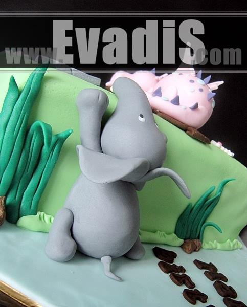 Picture of Elephant Climbing up Cake