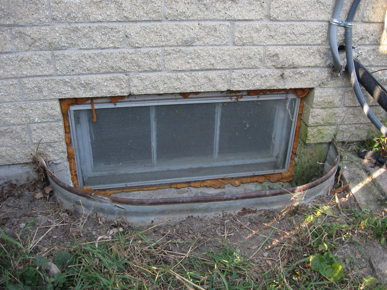 the new window well which is about 8 inches deeper than the originals