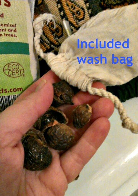 green virgin soap nuts into wash bag
