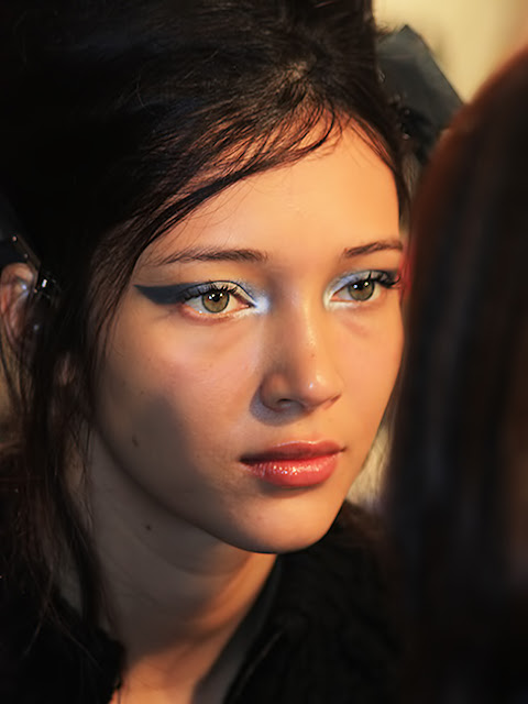 backstage at the Fashion Week shows.