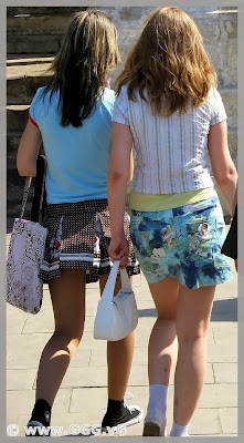 Girls in summer skirts on the street