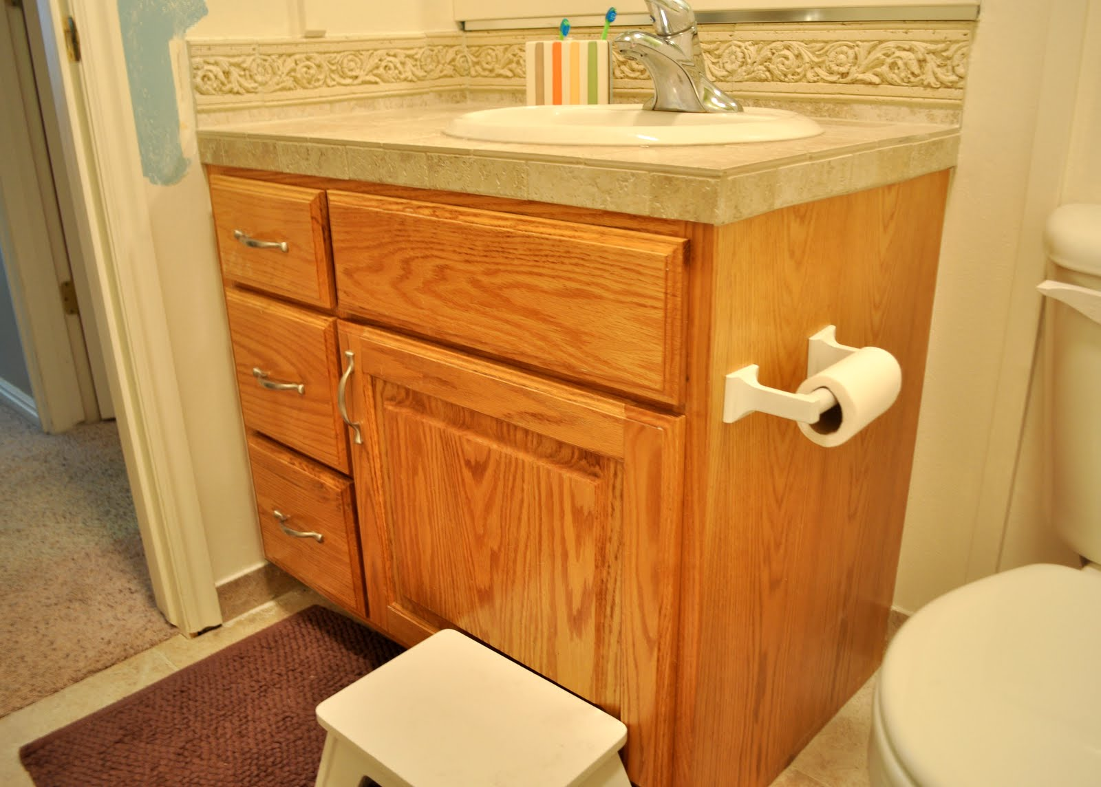 Sassy sanctuary bathroom cabinet before and after for Bathroom ideas with oak cabinets