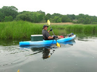 Photo of Justin kayaking