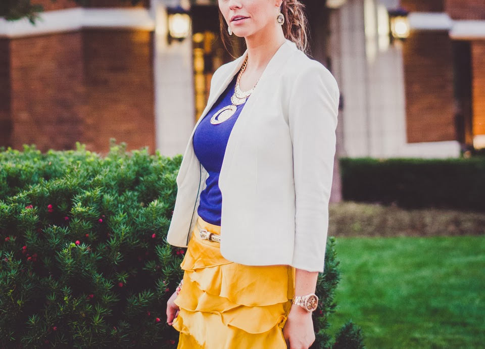 a girl in a bright yellow, ruffled skirt looks fashionable in an editorial style photoshoot in fishers, carmel indiana
