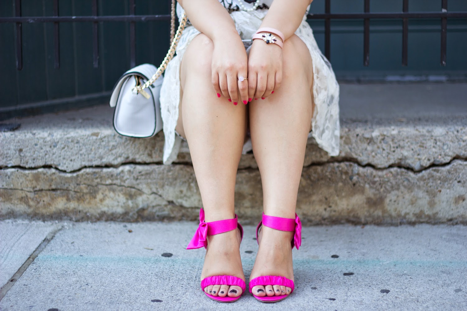 black-and-white-graphic-dress, statement-necklaces, pink-pumps-with-bows