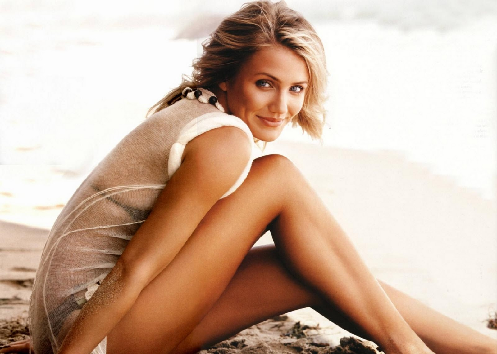 Cameron Diaz posing with a surfboard and ...