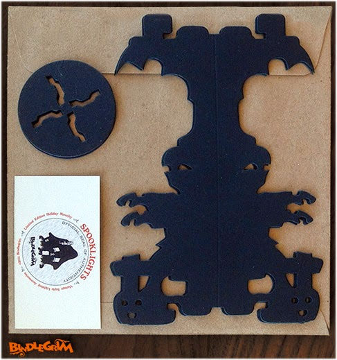 Paper good decorations in a vintage style by Halloween holiday artist Bindlegrim features classic style silhouettes for spooky atmosphere lighting