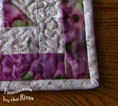 Closeup of binding sewn on at Freemotion by the River