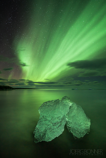 Northern lights and a chunk of ice.