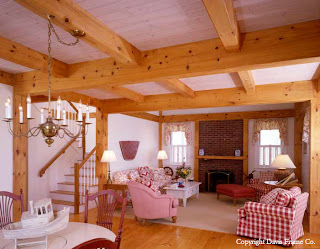 Eastern white pine and white washed tongue and groove complement this island timber frame home