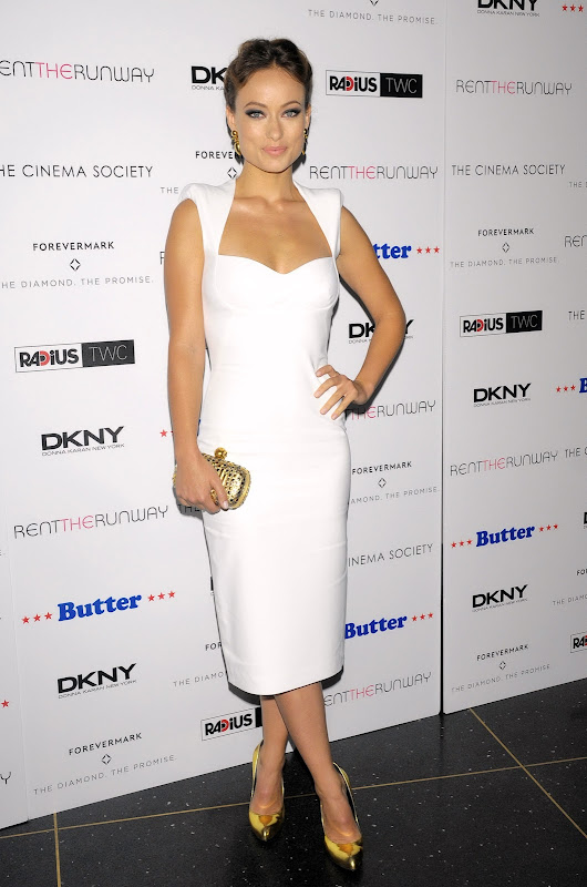 Olivia Wilde wearing a white dress