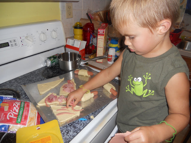 Add toppings to crescent rolls