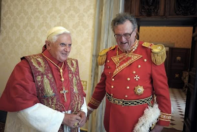 Pope Benedict XVI speaks with the new Grand Master of the Knights of Malta, Matthew Festing of Britain, during their meeting at the Vatican