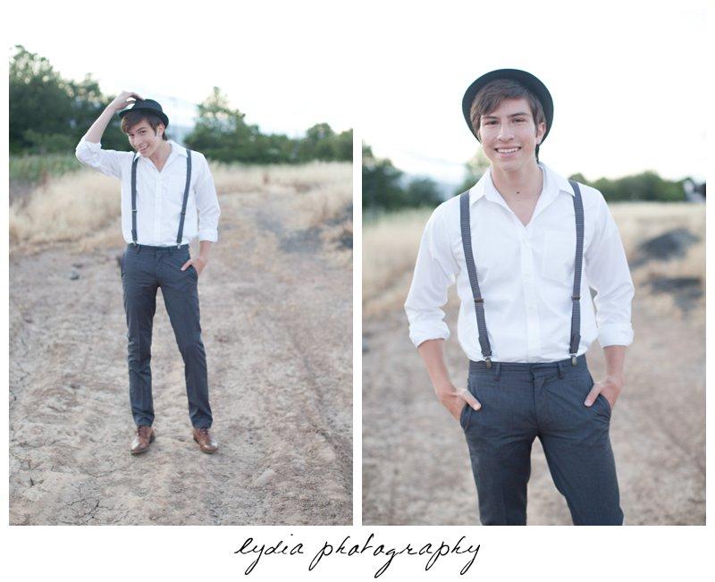 Senior guy holding his hat and laughing at Forest Lake Christian senior lifestyle portraits in Rocklin, California